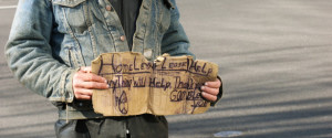 Homeless Man with Dirty Old Sign